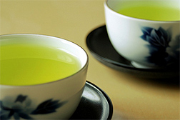 Photo: Two teacups filled with green tea.