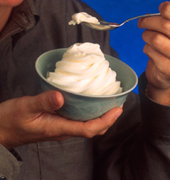 A bowl and spoonful of soft-serve ice cream