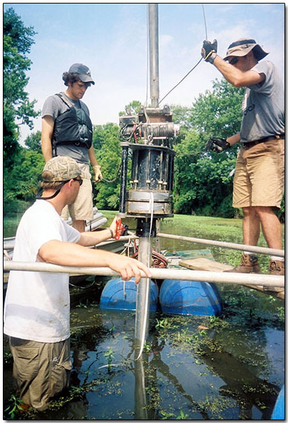Use of vibracore apparatus to extract deep sediment core from study backwater