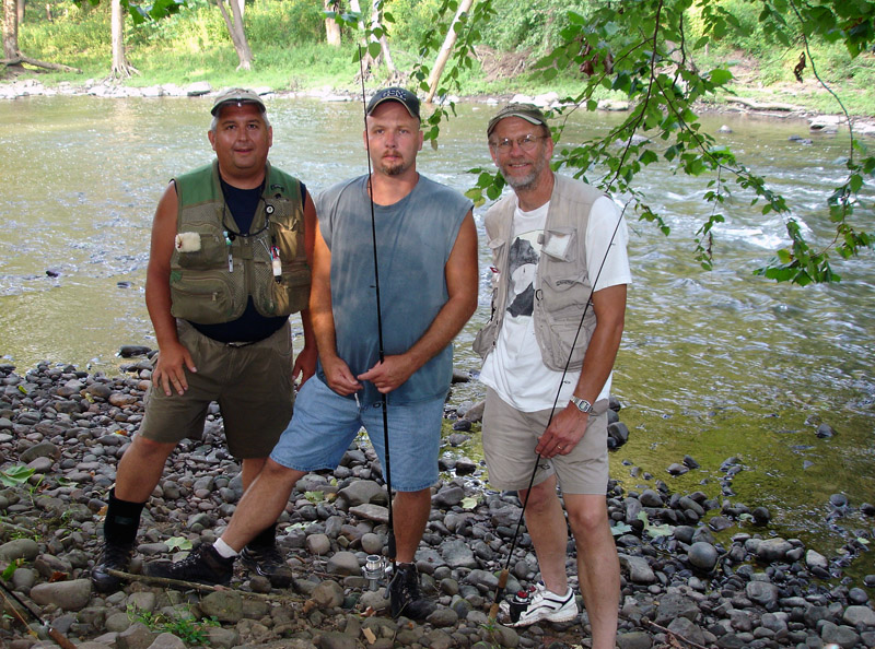 Three fishermen standing by the Bluestone National River
