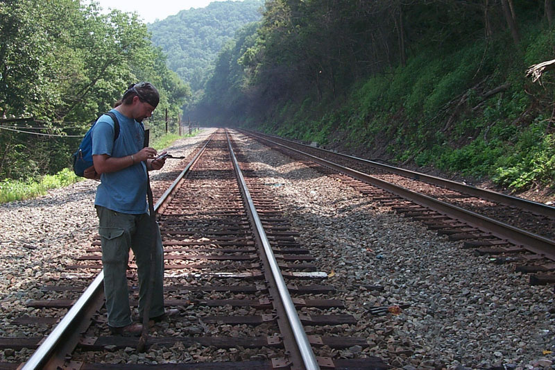 Technician crossing railroad track