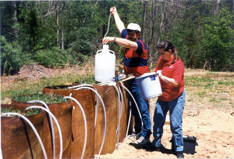 Employees collecting samples with a lysimeter.
