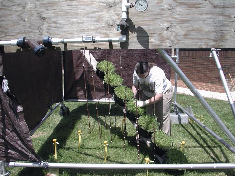 Employee prepares rain simulator