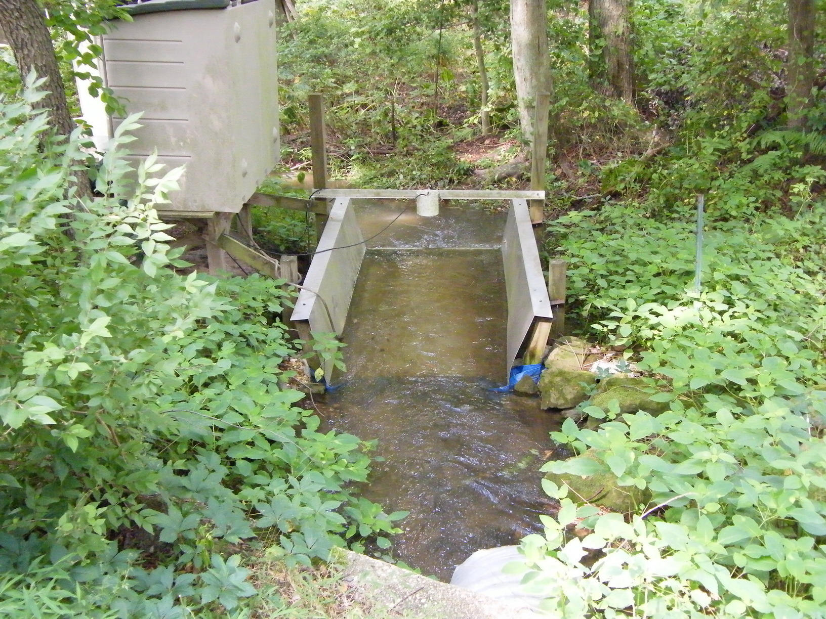 A flume to measure stream flow and to sample water at the Beaver Dam Tributary Creek at the Beltsville OPE3 site.  Photo by A.K. Guber.