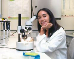Photo of Dr. Alicia Timm at the microscope