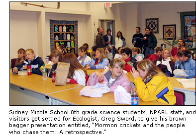 Photograph of Sidney Middle School 8th grade science students, NPARL staff, and visitors getting settled for Ecologist, Greg Sword, to give his brown bagger presentation entitled,