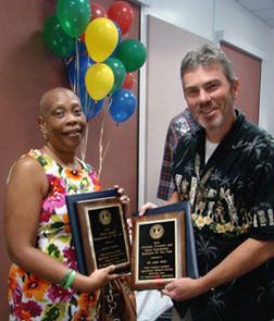 PSI Award Winner Ms. Elaine B. Jamison and Dr. Gary Miller accepting on behalf of Dr. Alma Solis.