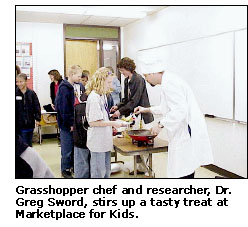 Grasshopper chef and researcher, Dr. Greg Sword, stirs up a tasty treat at Marketplace for Kids.