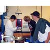 Thumbnail of students operating lab equipment