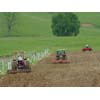 Thumbnail of tractors plowing field plot