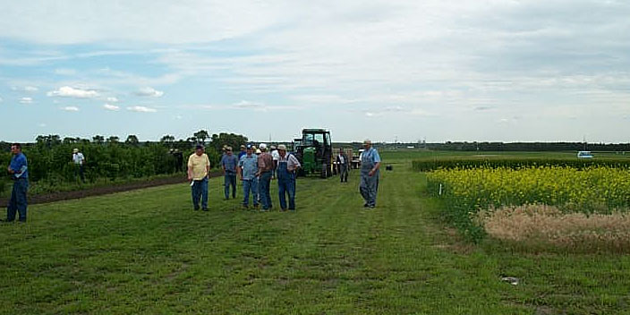 Customers Exploring Plots During a Field Tour
