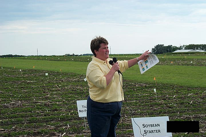 Scientist presents information at an annual field day.