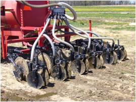Manure injection device for applying manure below the soil surface.