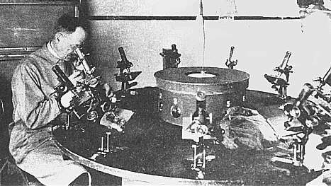 Cobb at microscope table