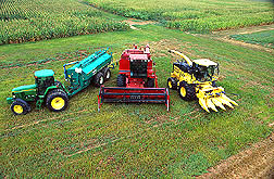 Photo: Three farm machines, in a field, that are powered by a mixture of diesel fuel and biodiesel. Link to photo information