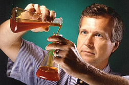 Chemist checks a corn fiber oil sample: Click here for full photo caption.
