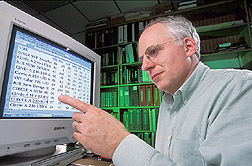 Geneticist examines results from genetic analyses of sires: Click here for full photo caption.
