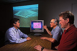 Soil scientist, chemist, and LABEX coordinator discuss use of data for soil analyses: Click here for full photo caption.
