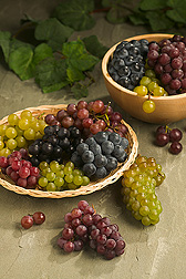 Display of green, red, purple and black grapes. Link to photo information