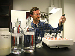 Chemist performs a test to determine how much sorbitol citrate is needed to prevent scale, the crusty buildup of calcium carbonate from so-called hard water: Click here for full photo caption.