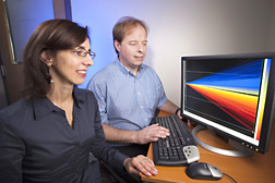 Photo: ARS microbiologists Maria Brandl and Craig Parker study data on a computer screen to identify E. coli O157:H7 genes. Link to photo information