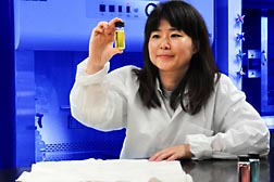 Chemist Sunghyun Nam examines suspensions of silver nanoparticles: Click here for full photo caption.