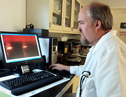 Microbiologist Michael Day examines the validation results of a new molecular diagnostic assay for a turkey picobirnavirus: Click here for full photo caption.