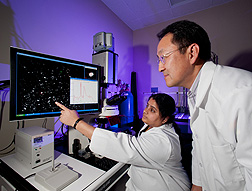 Agricultural engineer Bosoon Park (right) and postdoctoral research associate Jaya Sundaram examine a hyperspectral microscope image of an experimental substrate developed for SERS food-safety analyses: Click here for photo caption.