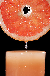 ARS scientists are using mass spectrometry of red grapefruit juice to determine differences in fruit grown conventionally versus organically: Click here for photo caption.