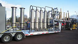 ARS scientists at Wyndmoor, Pennsylvania, are developing this mobile pyrolysis processing system that may one day be used on farms to produce bio-oil: Click here for photo caption.