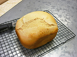 Photo: A loaf of white bread, baked with rice bran oil extract, cooling on a rack. Link to photo information