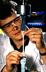 Chemist Stein tests the strength and flexibility of a starchbased plastic sample.
