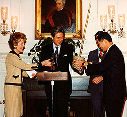 First Lady Nancy Reagan presents a regrown Yoshino cherry tree to Japanese Ambassador Yoshio Ogawara.