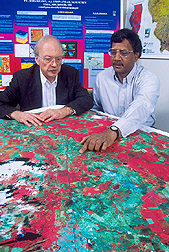 Meteorologist and NASS employee observe a remote-sensing map: Click here for full photo caption.