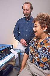 Endocrinologist checks a volunteer's blood pressure: Click here for full photo caption.