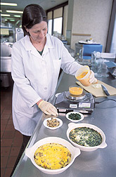 Dietitian weighs exact amounts of lutein-enriched eggs and other ingredients: Click here for full photo caption.