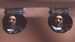 Photo: Allen Taylor as seen through rat's eye lenses with cataracts (left) and without (right). Link to photo information