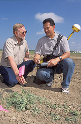 Photo: Plant physiologist and technician locate seed bank samples with GPS coordinates. Link to photo information