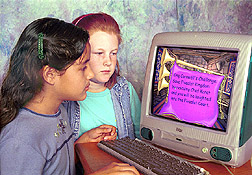 Photo: Two 4th grade students play nutrition computer game.