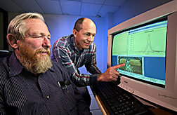Two hydraulic engineers work on simulating stages of the dam-breach process: Click here for full photo caption.