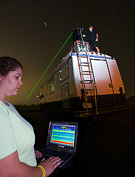 Technician examines the output from the LiDAR mounted atop the mobile laboratory: Click here for full photo caption.
