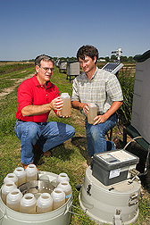 Soil scientist and biologist inspect samples of water runoff: Click here for full photo caption.