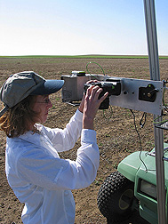 Lori Wiles sets up a camera and GPS unit. Link to photo information