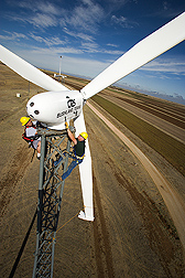 Agricultural engineer and mechanical engineer perform quarterly service on a wind turbine: Click here for full photo caption.