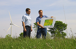 Electrical engineer and agricultural economist look at a map they developed for identifying potential best-bet locations for wind turbines: Click here for full photo caption.