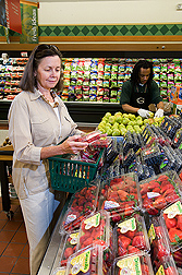 A shopper selects berries and other fruit for their ORAC (Oxygen Radical Absorbance Capacity) value: Click here for full photo caption.