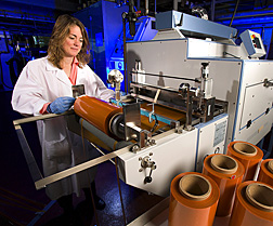A research leader for the Processed Foods Research Unit casts carrot wrap into rolls: Click here for full photo caption.