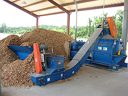 Fresh WholeTree chips being processed into a substrate component at Young's Plant Farm: Click here for photo caption.