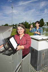 Chemists use air and rain sample collection devices to study the fate of atmospheric pollutants in the Chesapeake Bay region: Click here for full photo caption.