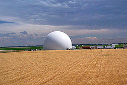 This dome is a weather facility at Greeley, Colorado, one of many stations that gather multiple years of climate data used in combination with a model to project future crop yields in response to various climate changes: Click here for photo caption.